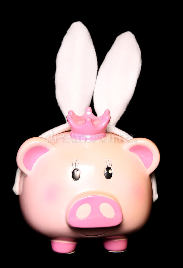 Orecchie di coniglio d'uso del porcellino salvadanaio fotografie stock libere da diritti