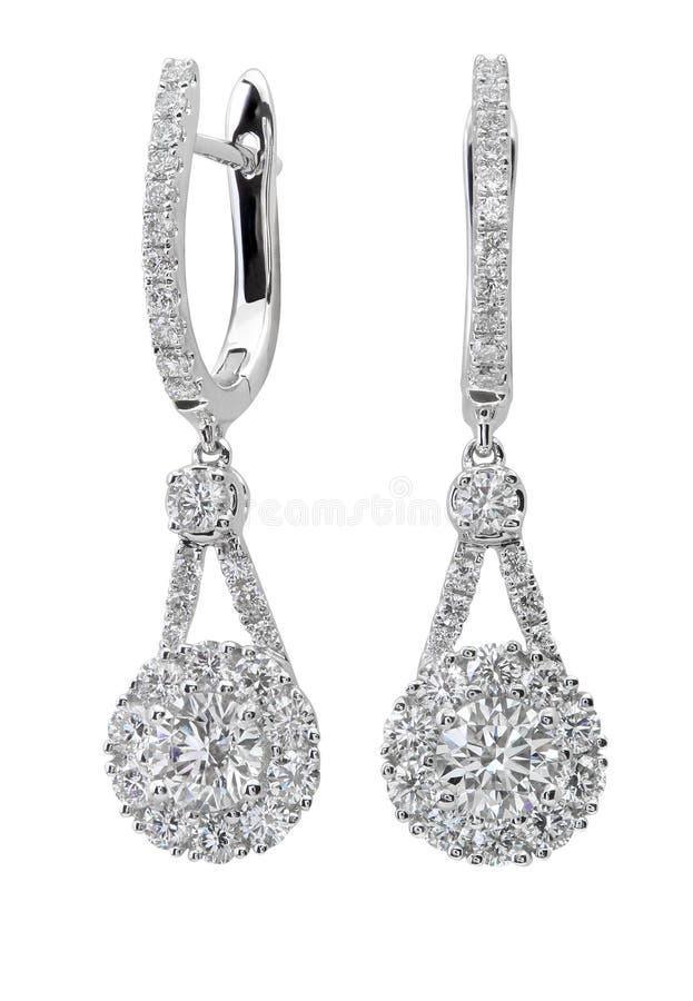 Orecchini del diamante su bianco fotografie stock libere da diritti