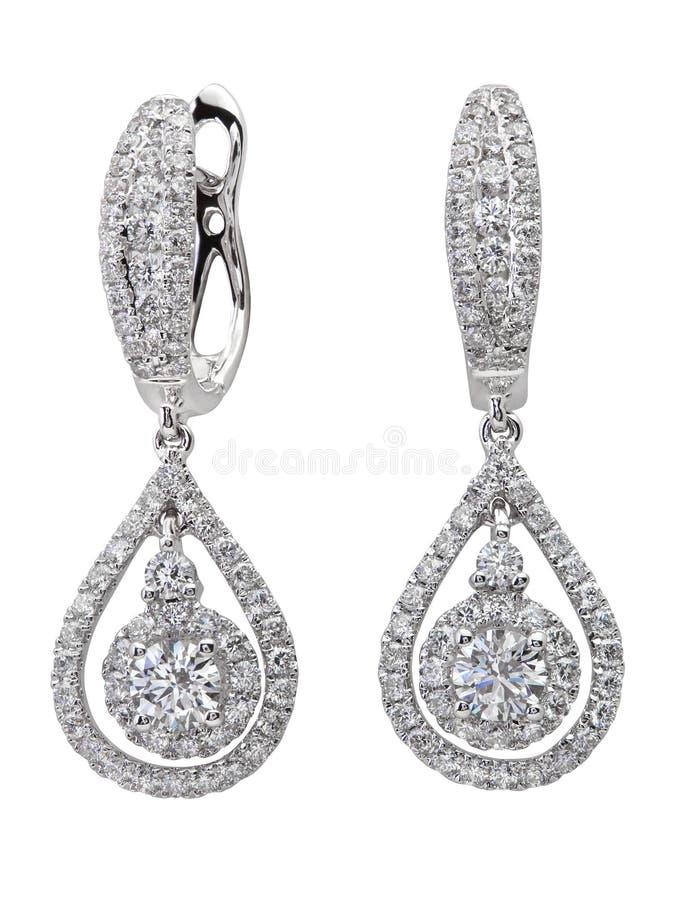Orecchini del diamante su bianco fotografia stock