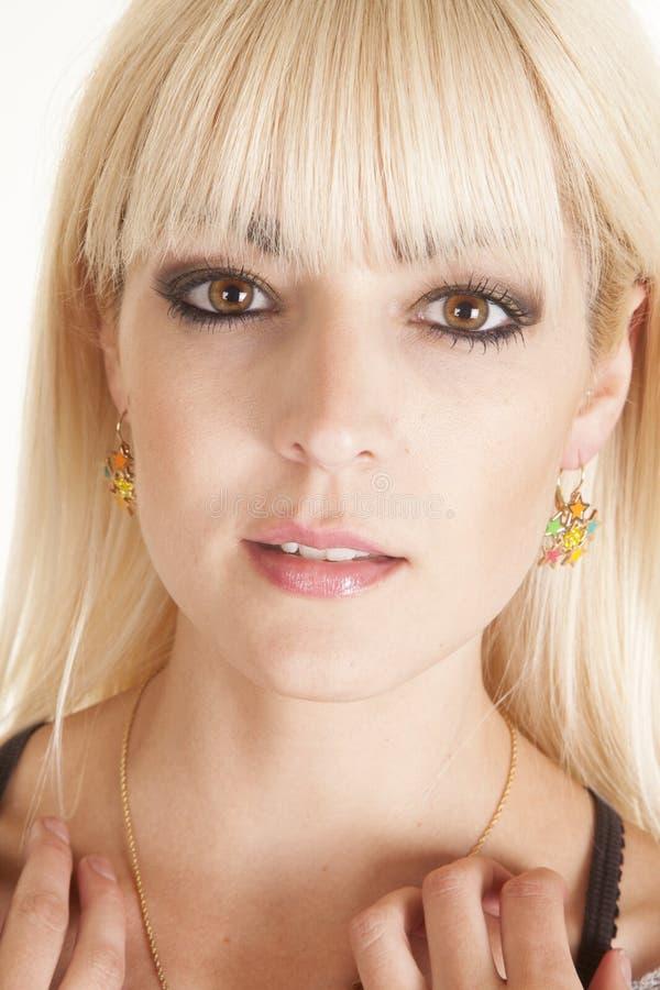 Orecchini della stella del collo di tocco della donna immagine stock