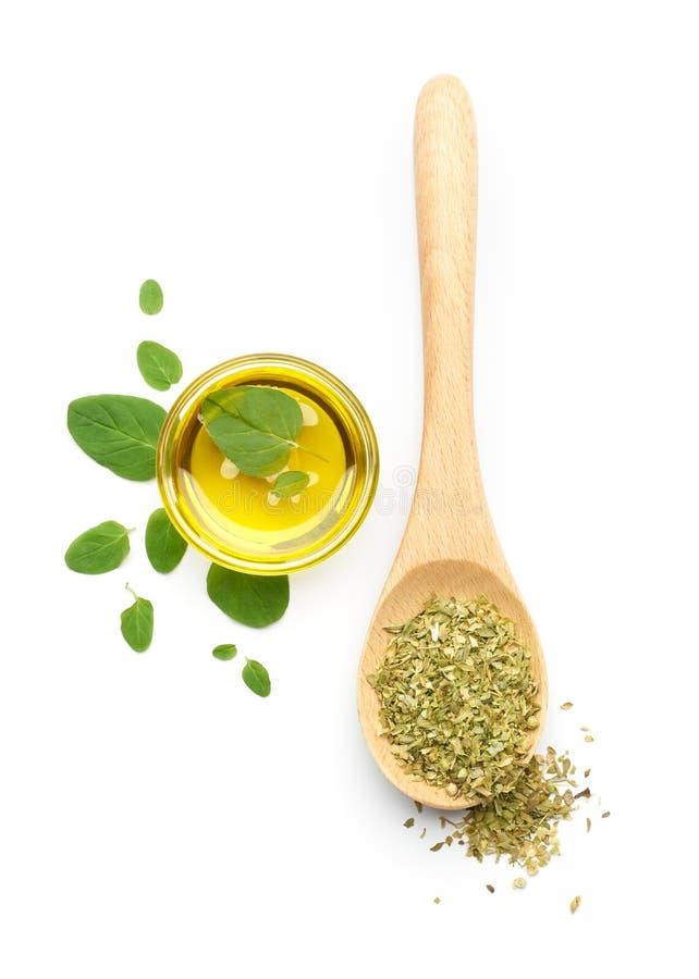 Oregobladeren, Droge Orego en Olive Oil stock afbeelding