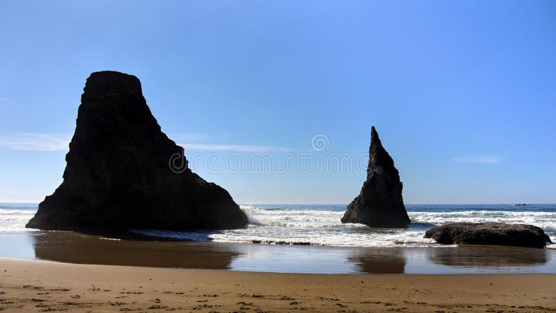 Oregon Coast Bandon Beach, Wizards Hat Rock stock images
