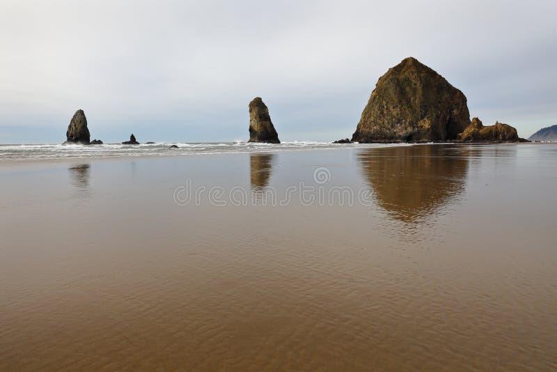 Oregon Coast Shore, Haystack Rock, United States. Haystack Rock on the Oregon Coast at Cannon Beach. United States royalty free stock image