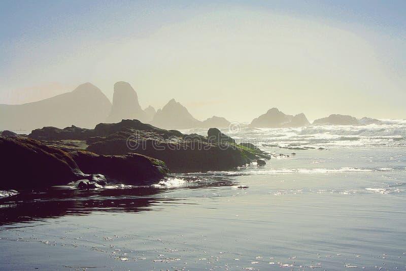 Oregon Coast. Some stubborn fog held on into the sunny afternoon stock photos
