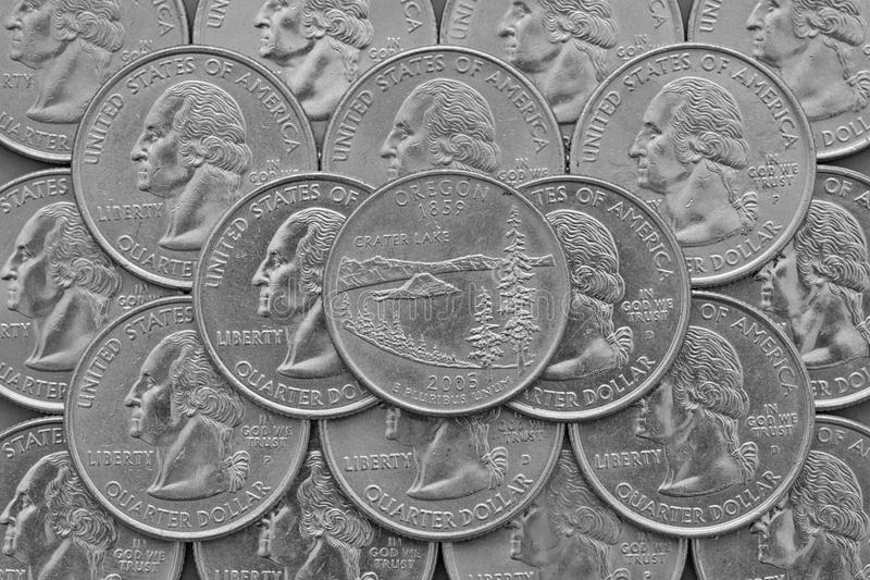Oregon State and coins of USA. Pile of the US quarter coins with George Washington and on the top a quarter of Oregon State royalty free stock photos