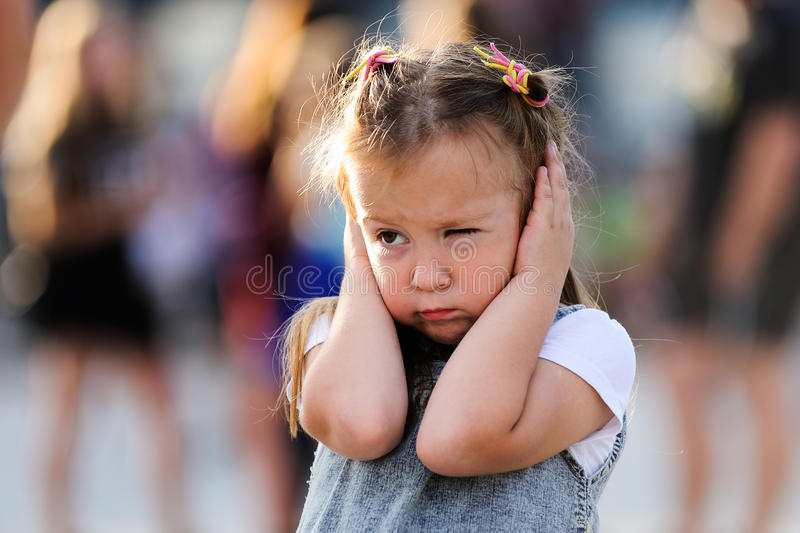 Orel, Russia, August 05, 2017: City Day. Little girl shuts her e royalty free stock photos