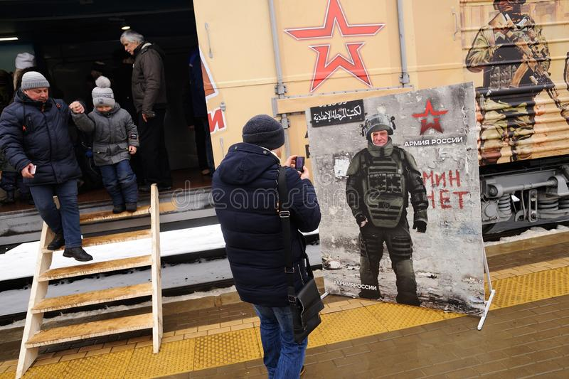 Orel, Russia, February 25, 2019: Syrian Break - trophy exhibition train of Russian Defence Ministry. People coming out of. Exhibition wagon and taking photos stock photo