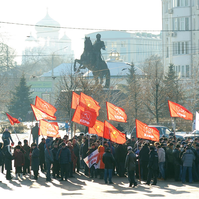 Orel, Russia - November 29, 2015: Russian truck drivers protest. Strikers with red communist flags, Ermolov monument and church background stock photos