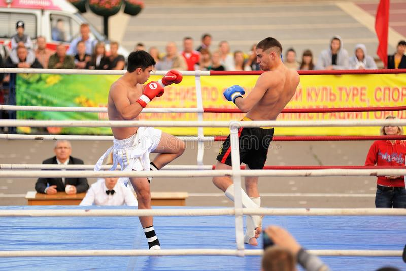 Orel, Russia, September 5, 2015: Male kickboxers fighting on the stock photography
