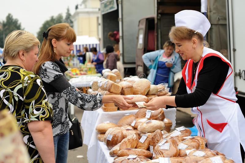 Orel, Russia, September 5, 2015: Women selling and buying pastry stock photos
