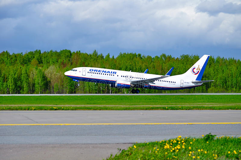 Orenair Airlines Boeing 737-800 airplane is taking off from the runway in Pulkovo International airport in Saint-Petersburg royalty free stock photography