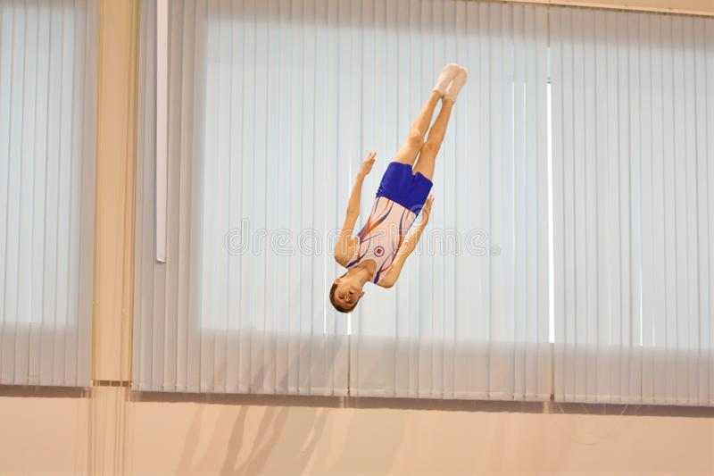 Orenburg, Russia December 3, 2016: The boys compete in jumping on the trampoline. Orenburg, Russia - December 3, 2016: boys compete in jumping on the trampoline royalty free stock photos