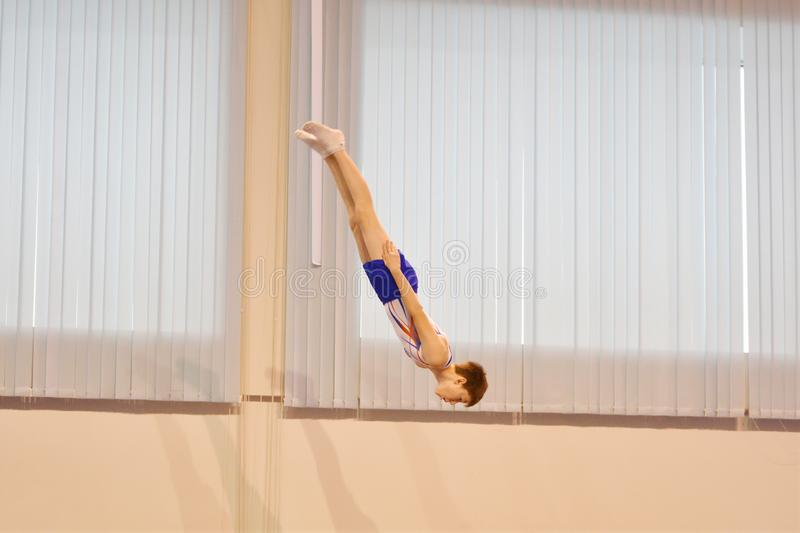 Orenburg, Russia December 3, 2016: The boys compete in jumping on the trampoline. Orenburg, Russia - December 3, 2016: boys compete in jumping on the trampoline royalty free stock image