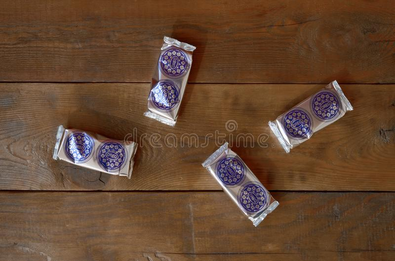 OREO sandwich cream biscuits mini packs on dark wooden background stock photo
