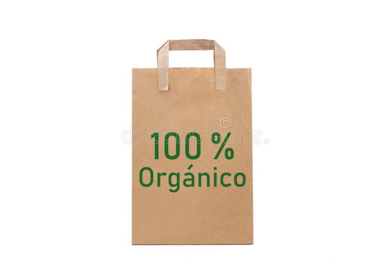 orgá nico organiskt ord 100% att skriva i en pappers- påse royaltyfria bilder