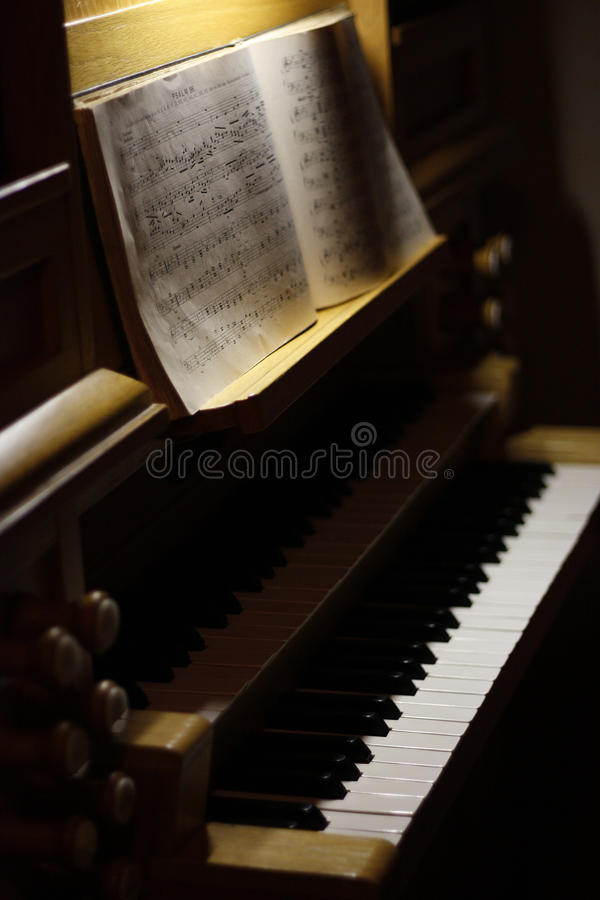 Organ. In low light ready to play music royalty free stock photo