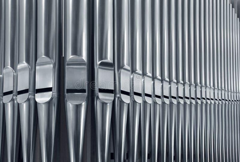 Organ pipes close. Close-up of modern steel organ pipe set horizontal royalty free stock image