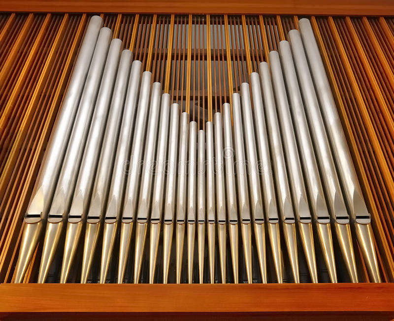 Organ pipes in music hall (church) stock photo