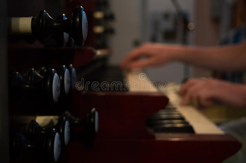 Organ playing royalty free stock photo