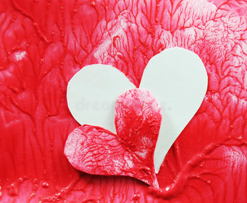 Organ transplant. Concept - two hearts and blood vessels stock photos