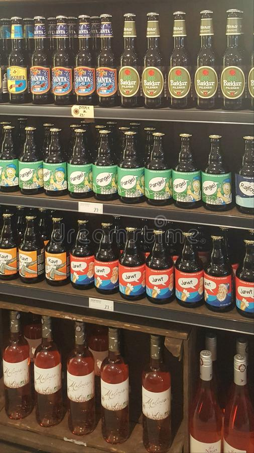 Organic ale, beer, wine, juice on display shelves of a local restaurant. Photographed in Aalborg, Denmark. stock photo