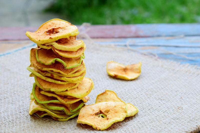 Organic apple chips. Dried fruits. Healthy sweet snack. Dehydrated and raw food. Copy space royalty free stock photos