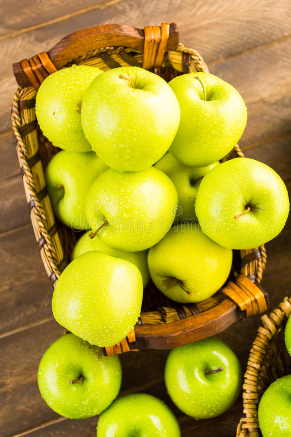Organic apples. Variety of organic apples in baskets on wood table stock images