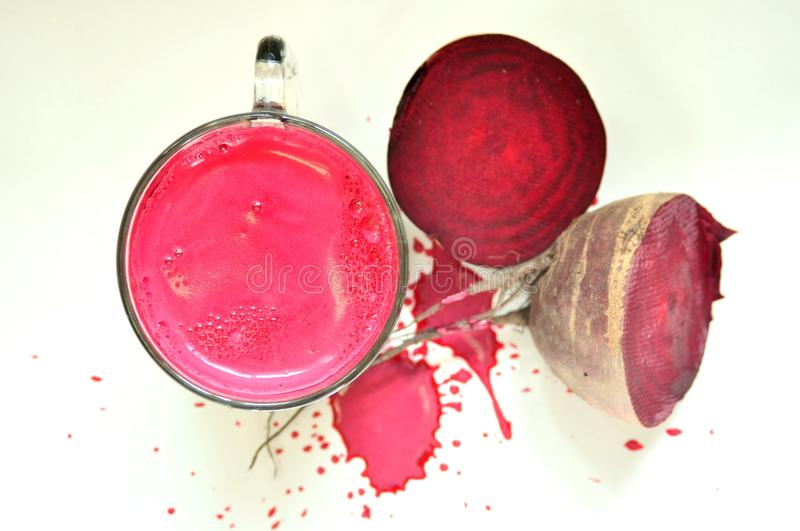 Organic beet juice on a white background stock images