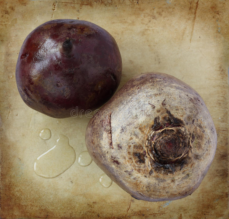 Organic beets on an old rustic stone chopping board. Still life composition from above royalty free stock photos