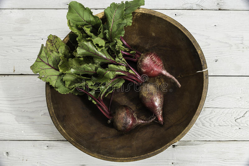 Organic beets in wooden bowl stock photos
