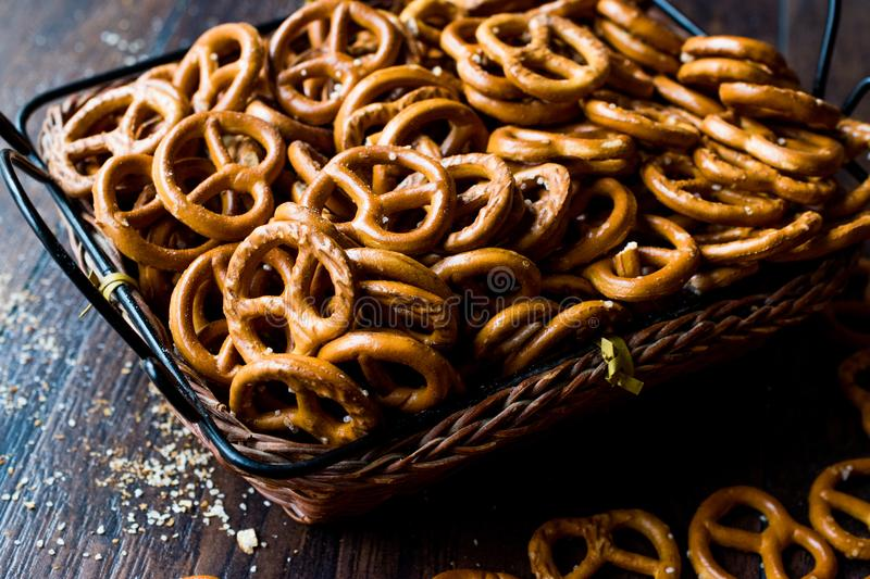 Organic Brown Mini Salty Pretzel Crackers in Wooden Basket. Traditional Food stock images