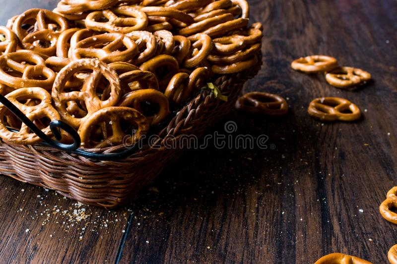 Organic Brown Mini Salty Pretzel Crackers in Wooden Basket. Traditional Food stock photos