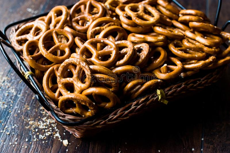 Organic Brown Mini Salty Pretzel Crackers in Wooden Basket. Traditional Food royalty free stock photos
