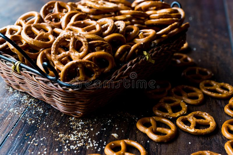 Organic Brown Mini Salty Pretzel Crackers in Wooden Basket. Traditional Food royalty free stock images