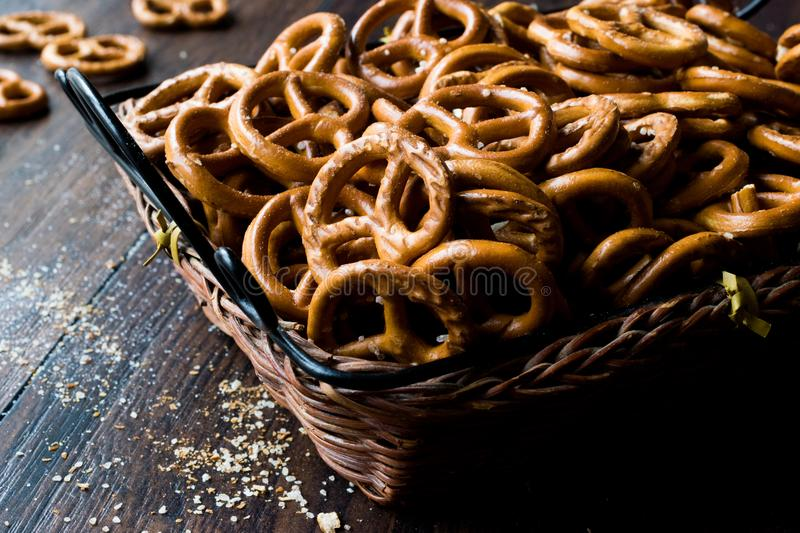 Organic Brown Mini Salty Pretzel Crackers in Wooden Basket. Traditional Food royalty free stock photography