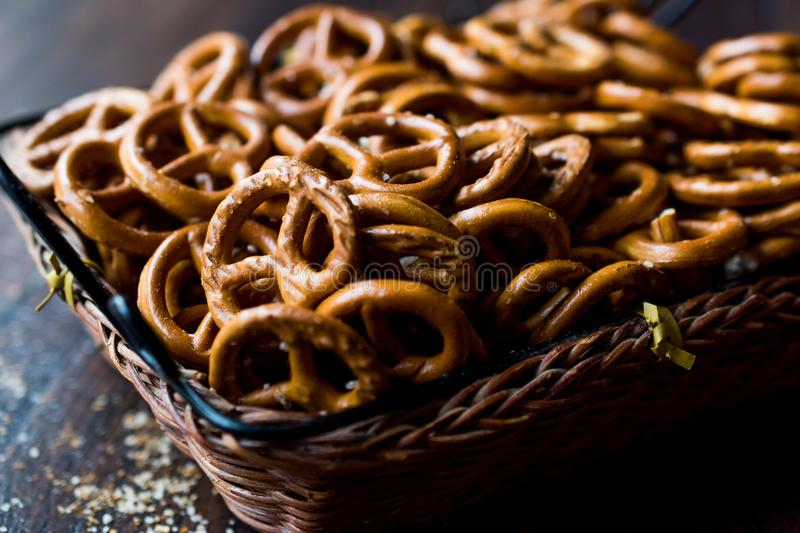 Organic Brown Mini Salty Pretzel Crackers in Wooden Basket. Traditional Food royalty free stock image