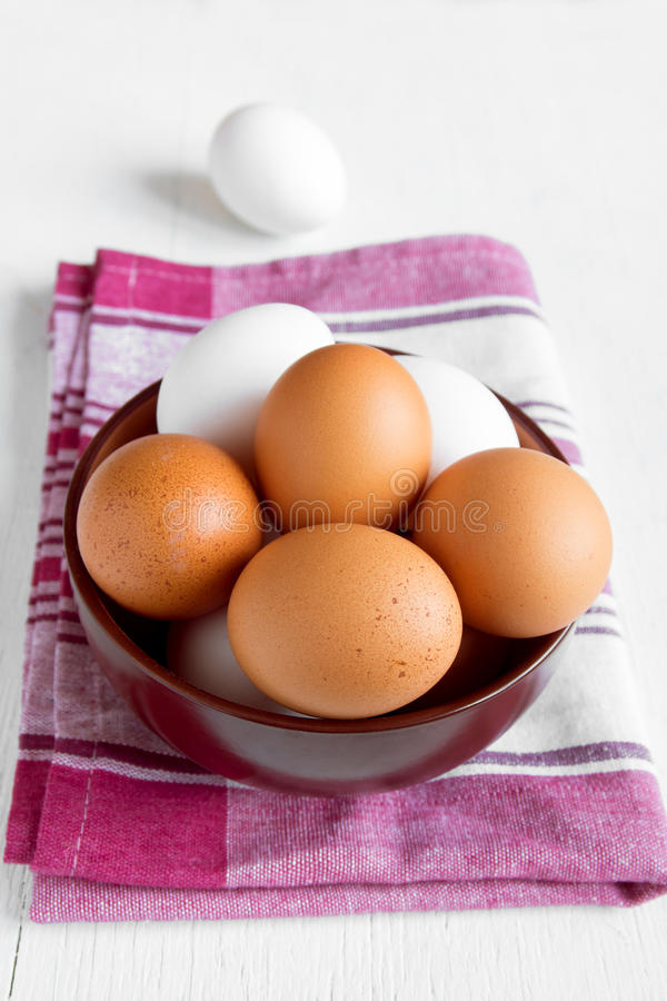 Organic brown and white eggs stock photos