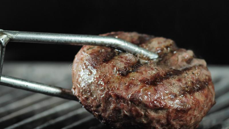 Organic burger cutlet cooked on the grill. concept of nature and creation of natural products royalty free stock photography
