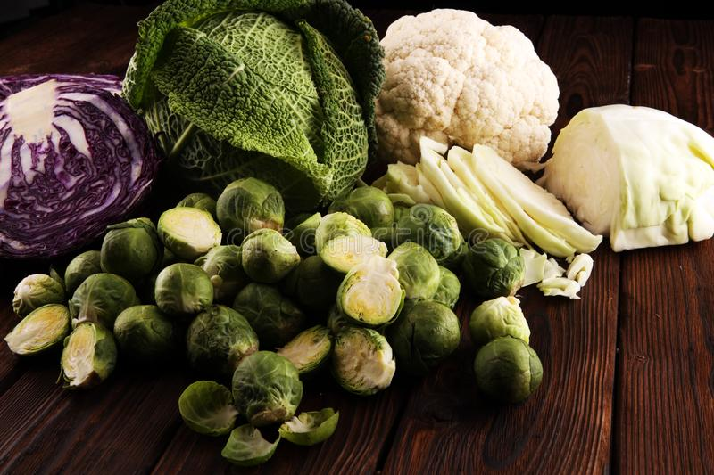 Organic cabbage heads. Antioxidant balanced diet eating with red cabbage, white cabbage and savoy. cauliflower. And Brussels sprouts royalty free stock photo