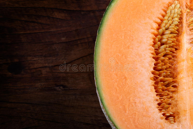 Organic cantaloupe on wooden table.  royalty free stock photo