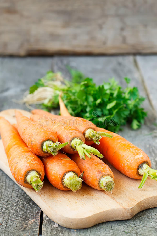 Organic carrots on a wooden background.  royalty free stock photography