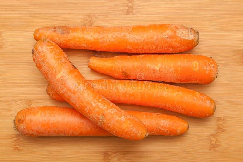 Organic Carrots on wooden table. Shot of oganic Carrots on wooden table stock images