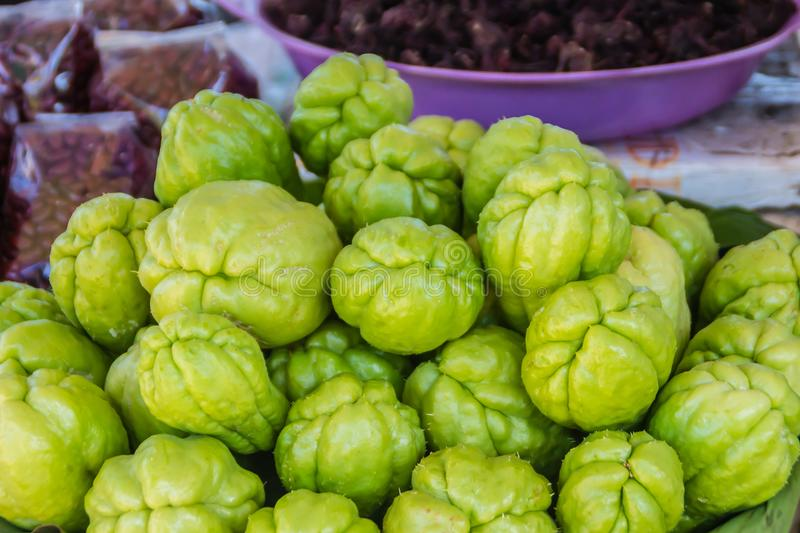 Organic Chayote fruits for sale in the market. Chayote Sechium edule is an edible plant that also known as christophine, cho-cho. Sayote, pipinola, pear squash stock image