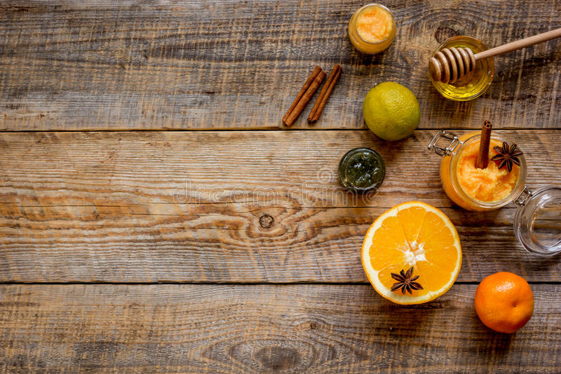 Organic citrus scrub homemade on wooden background top view.  stock photos