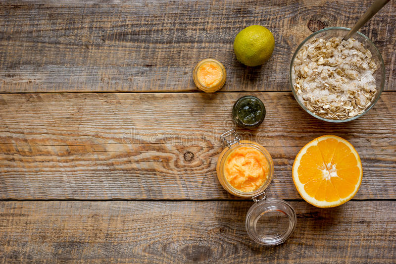 Organic citrus scrub homemade on wooden background top view.  royalty free stock photography