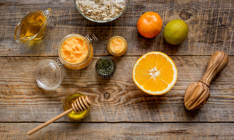 Organic citrus scrub homemade on wooden background top view.  royalty free stock photo