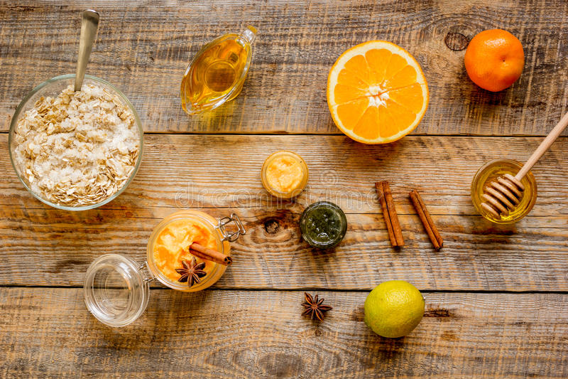 Organic citrus scrub homemade on wooden background top view.  royalty free stock image