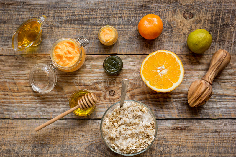 Organic citrus scrub homemade on wooden background top view.  royalty free stock images