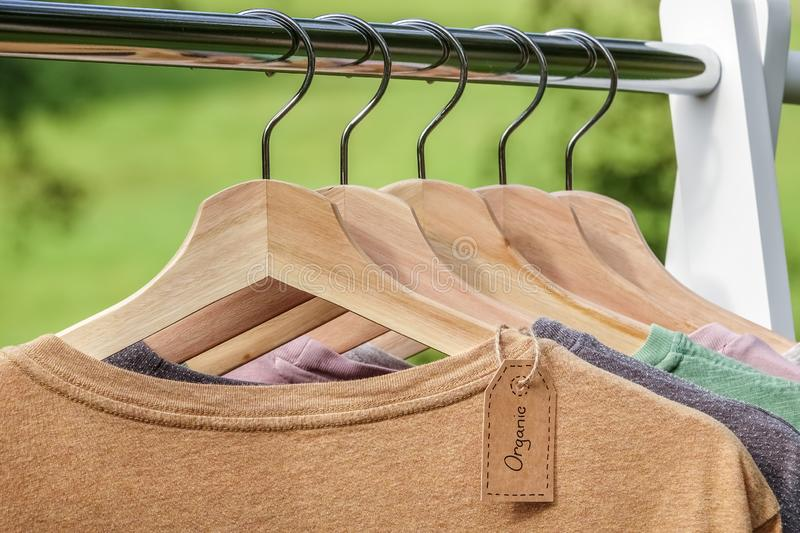 Organic clothes. Natural colored t-shirts royalty free stock photography
