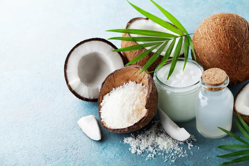 Organic coconut products for spa, cosmetic or food ingredients decorated palm leaves. Natural oil, water and shavings. Organic coconut products for spa stock image